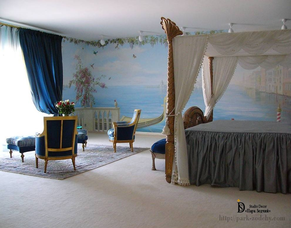 A bedroom with a painting in the lagoon on the wall