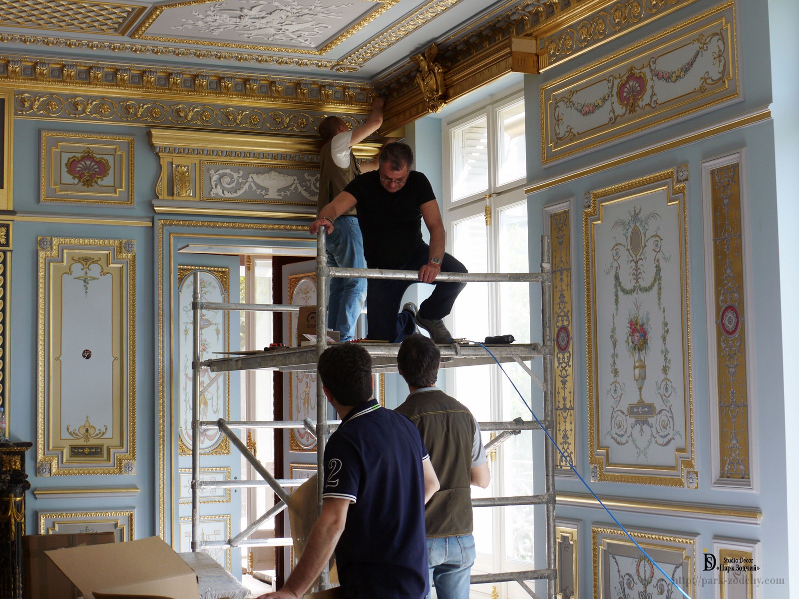 Applying gilding to decorative cornice