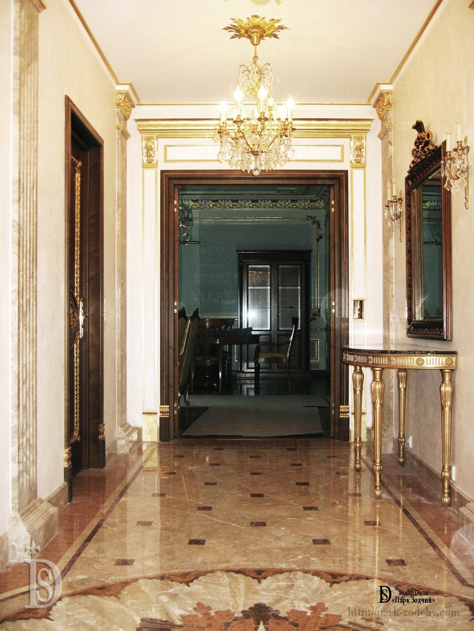 The hall is decorated with marble, stucco