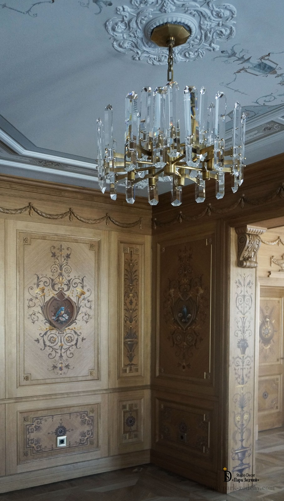 An interesting combination of boiserie, painting, carved elements in the cabinet