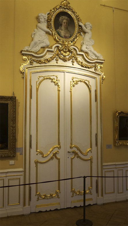The doorway is decorated with a moulded