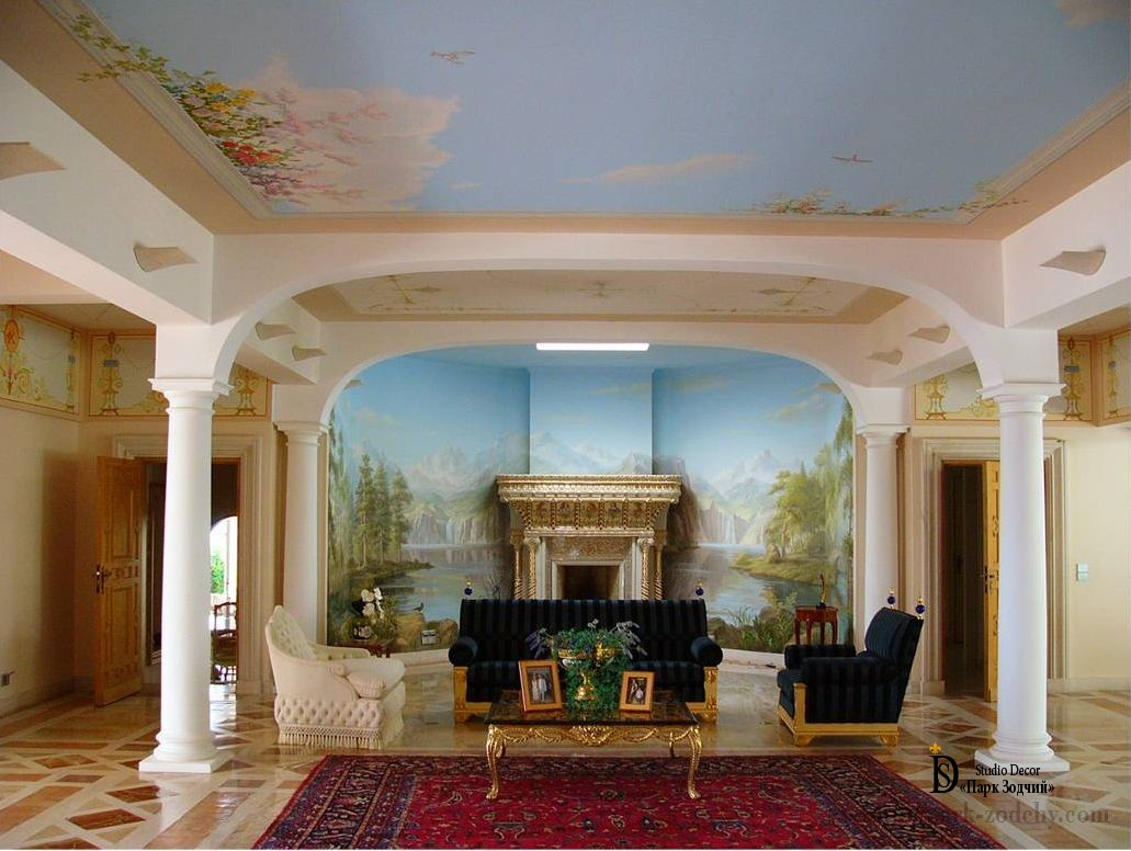 The interior of the living room with a fireplace, pillars and paintings