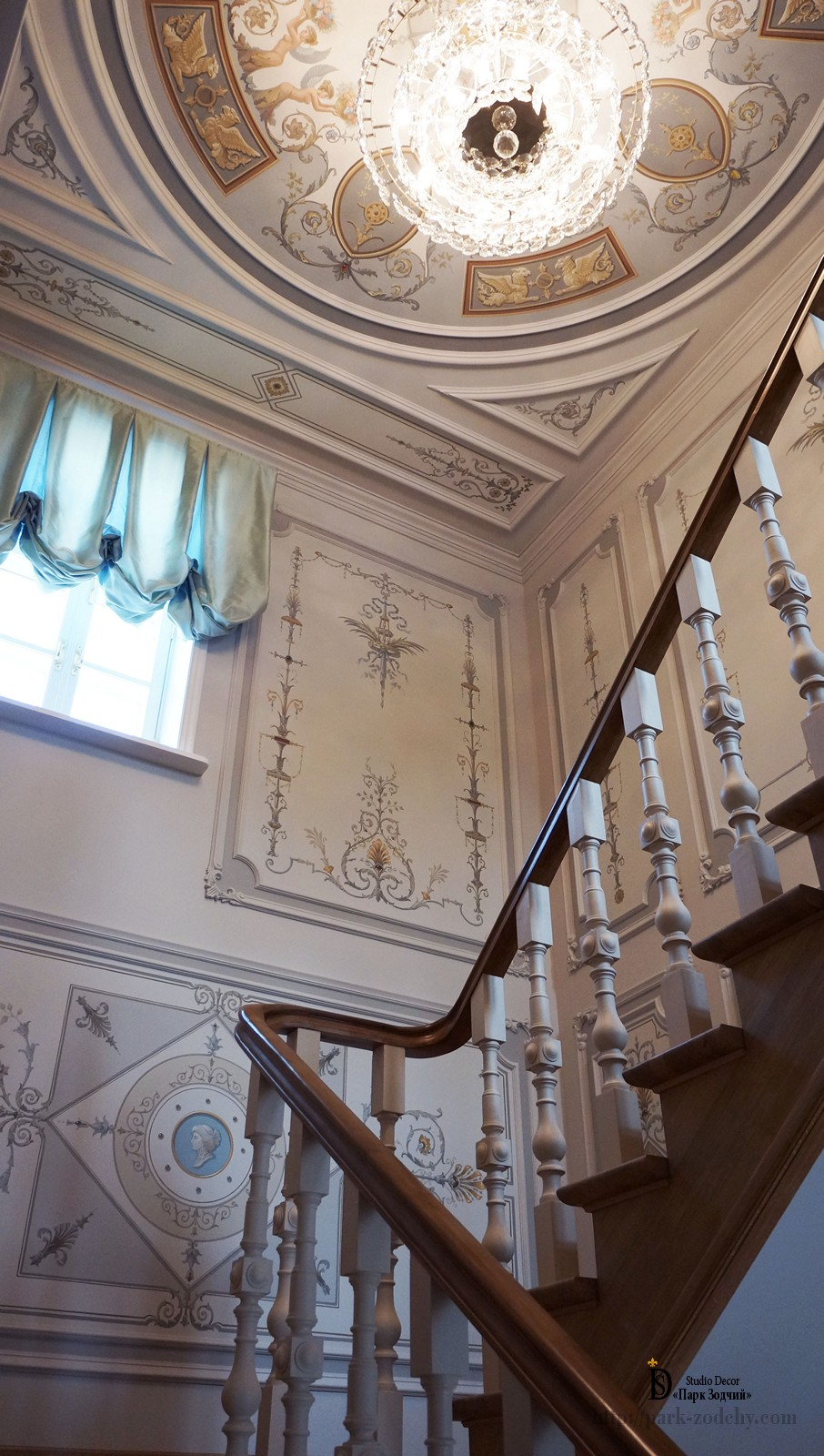 The main staircase is decorated with paintings almaney