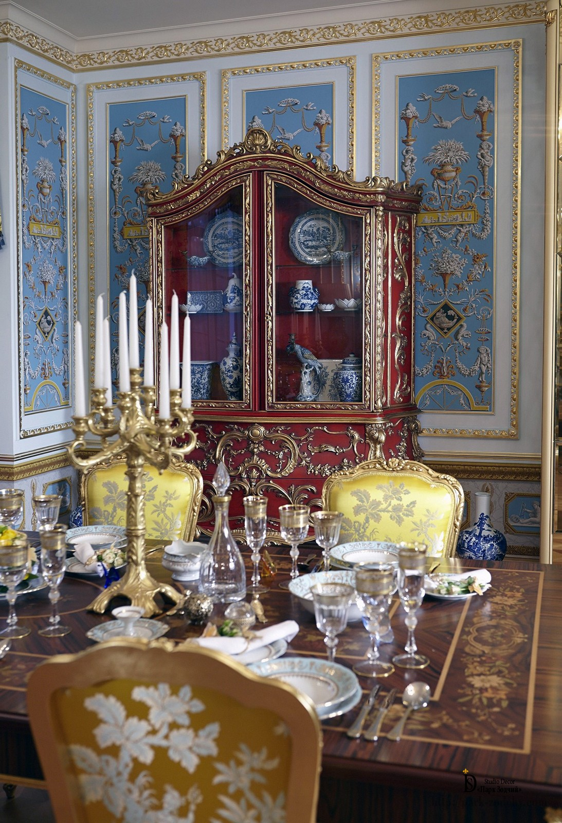 Baroque dining room with gilded stucco and decorative parquet