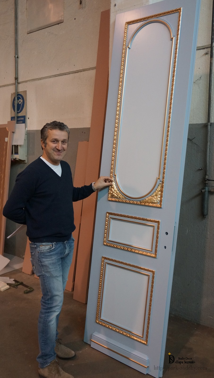 Gilding a wooden door in production