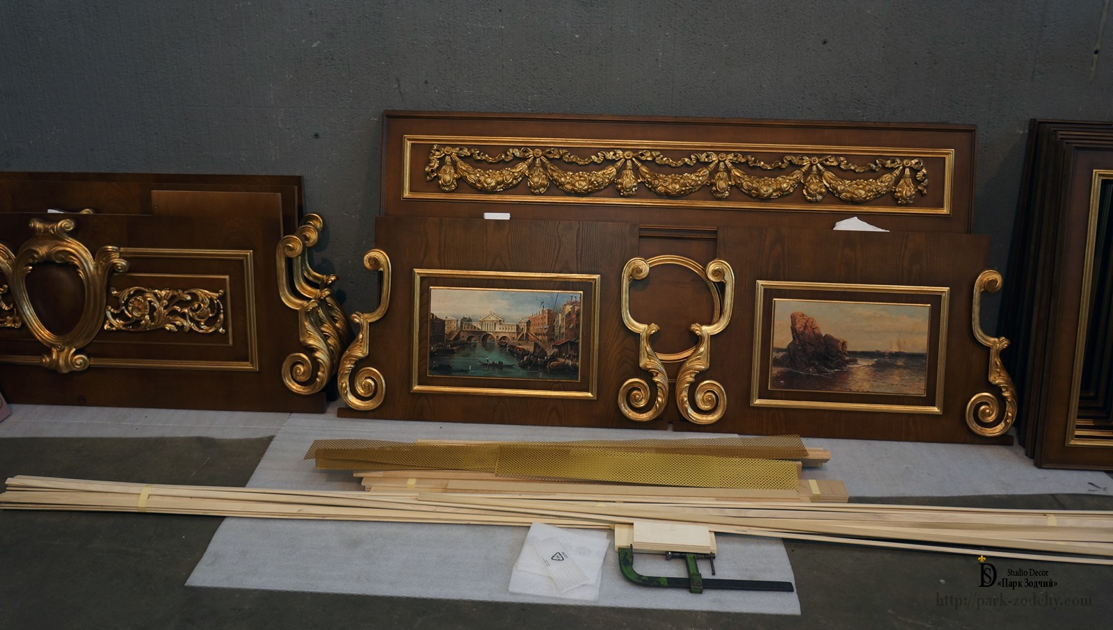 The overdoor with gilding and pictorial inserts