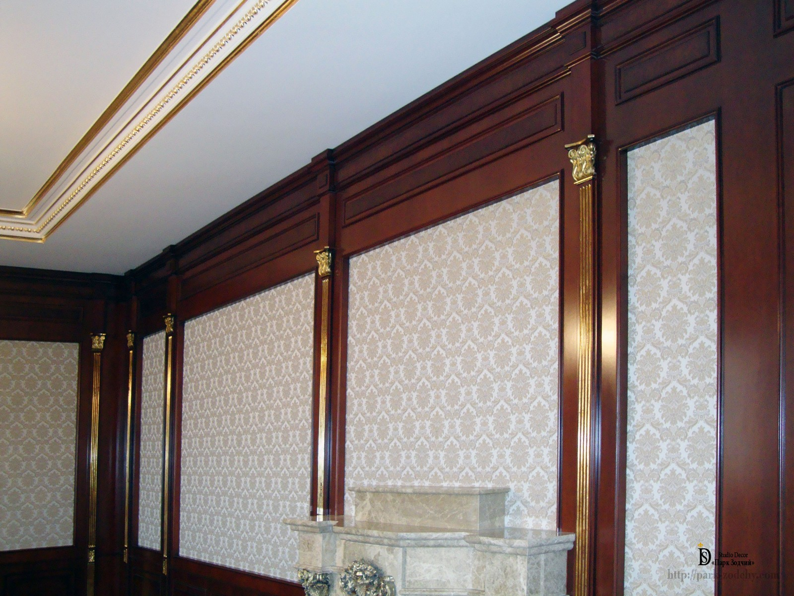Wooden decor with gilded pilasters