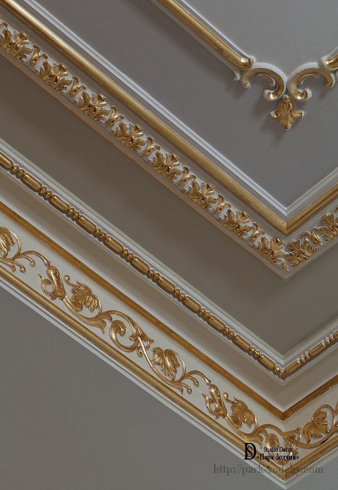 Gilding with gold leaf plaster cornice