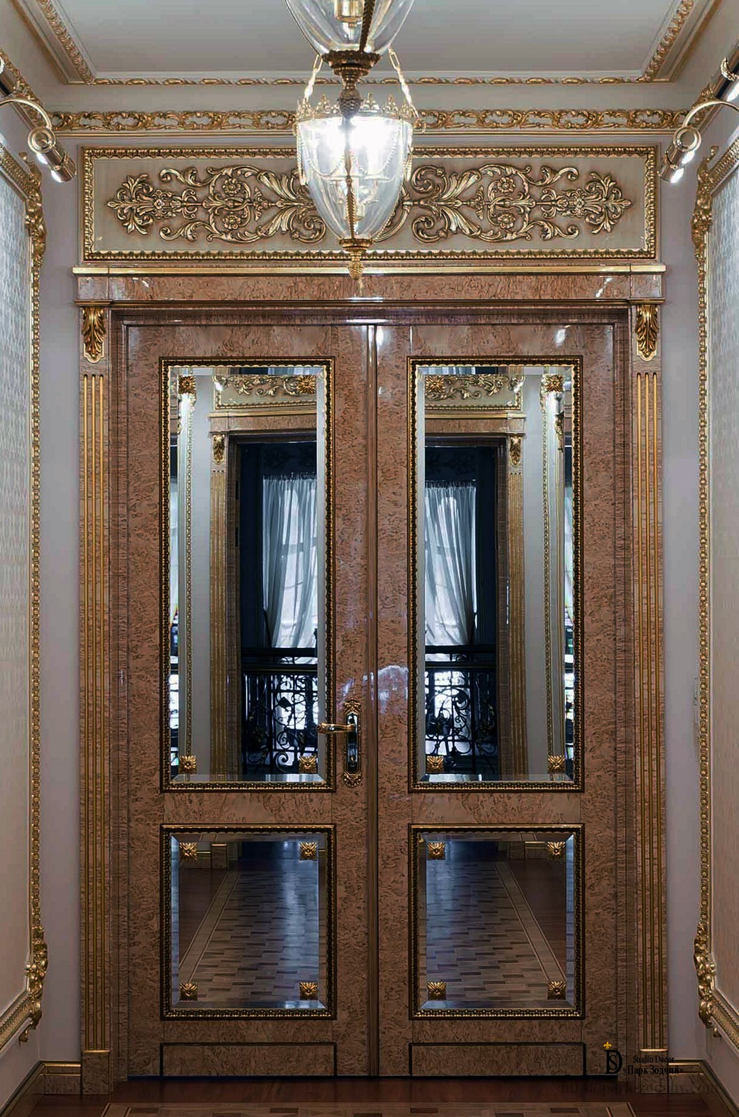Gilt plaster molding above the door