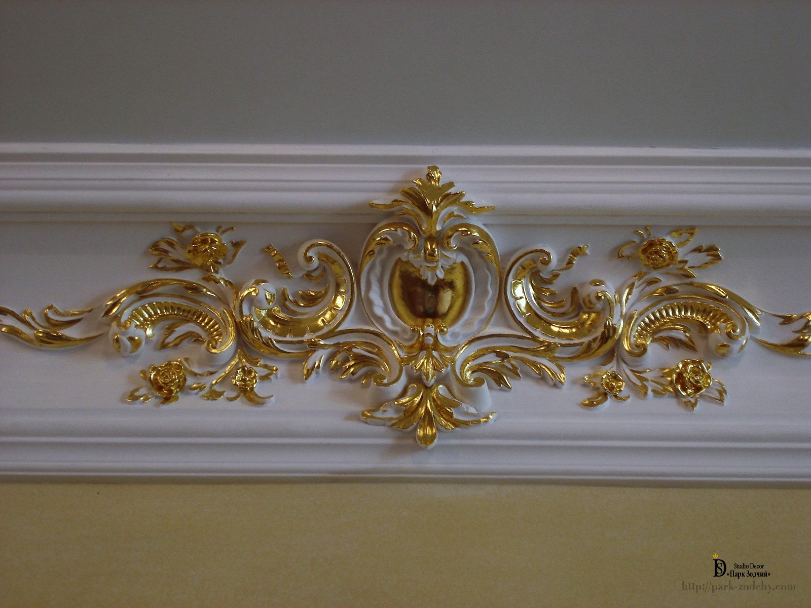 Gold leaf gilding cartouche in the classical style