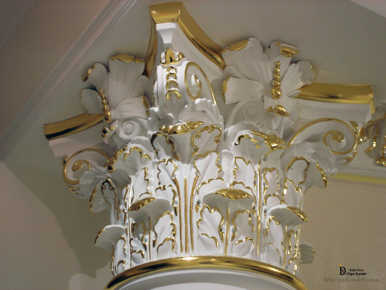 Leaf gilt plaster capitals