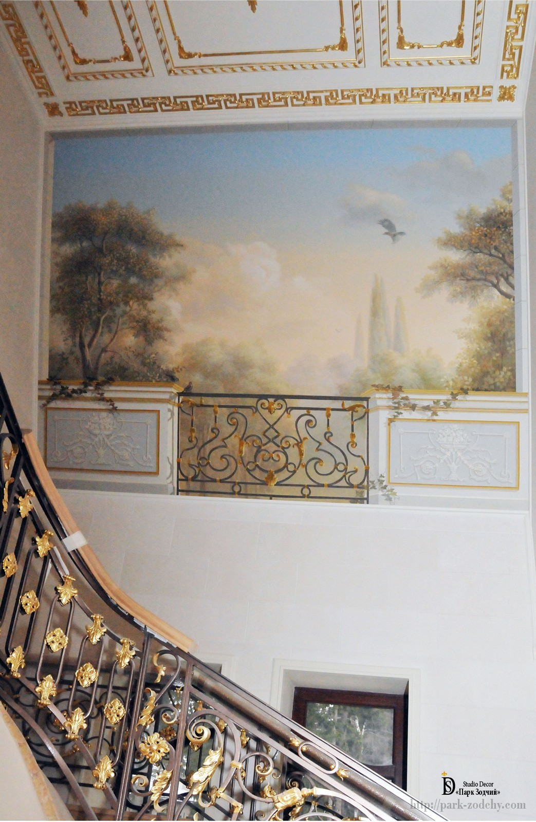 Painting the walls of the staircase of a country house