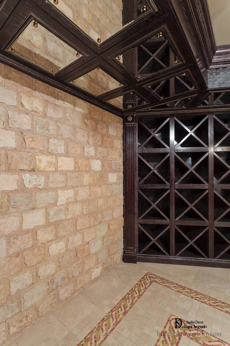 Wine cellar with mirrored panels for equipment