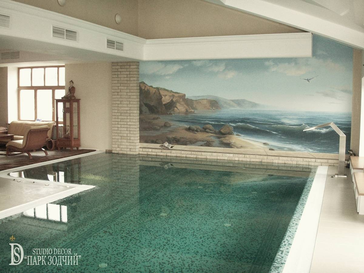 Pool with a hydromassage shower and a painting on the wall