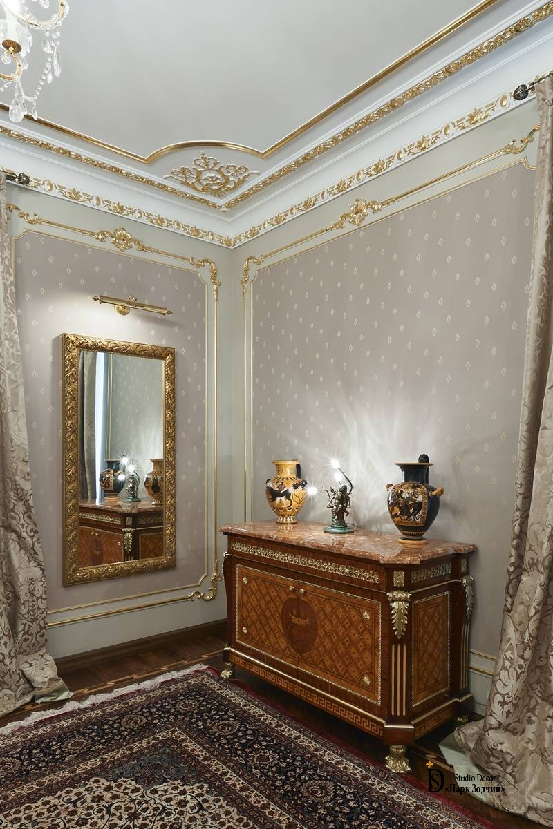 Bedroom interior with stucco and a large mirror