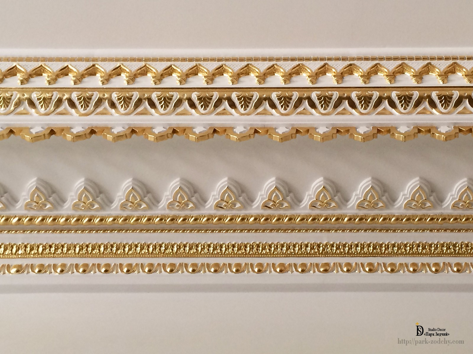 A plaster frieze with gilt and gold leaf