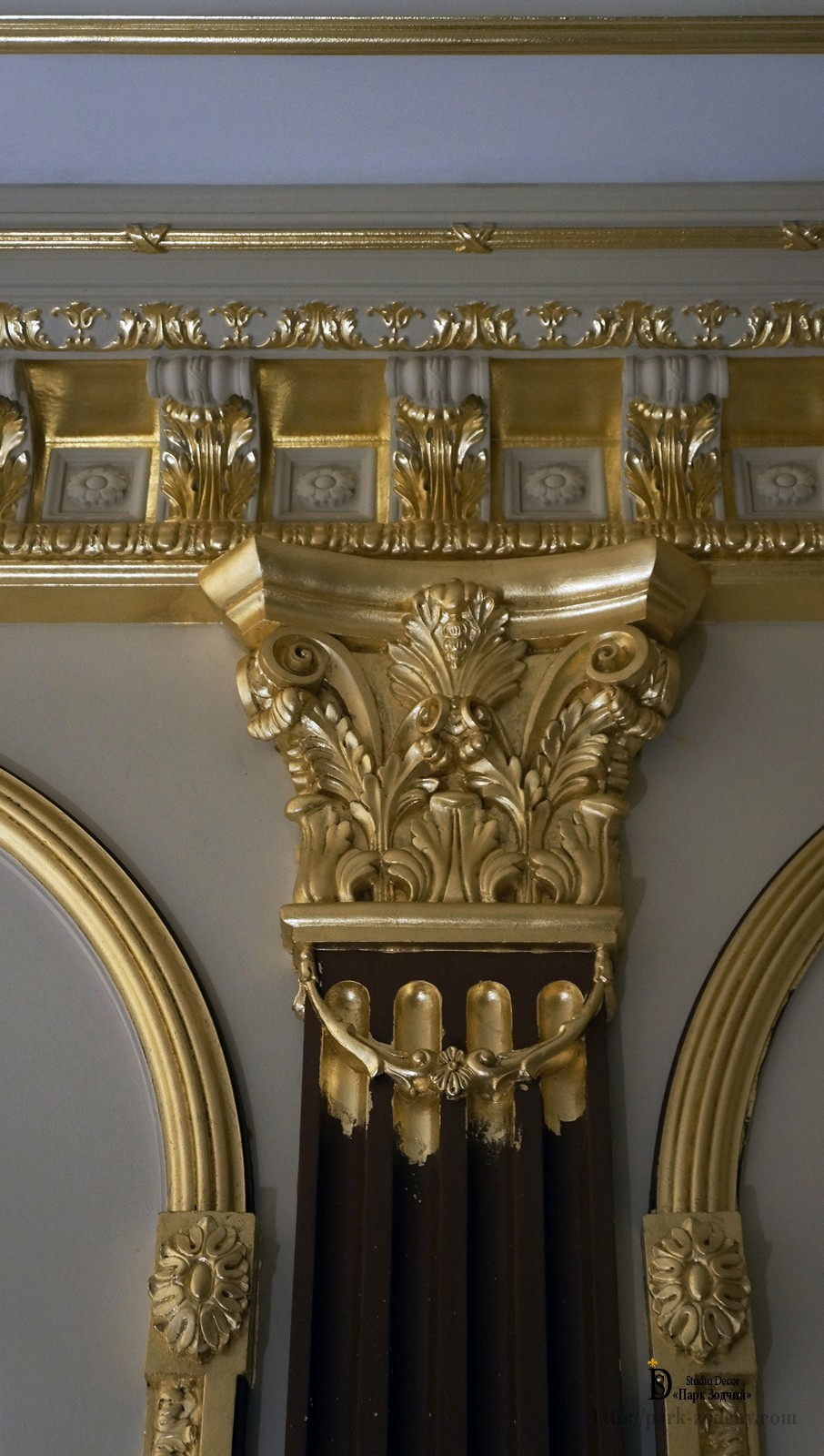 The gilding of the capitals in a classic interior