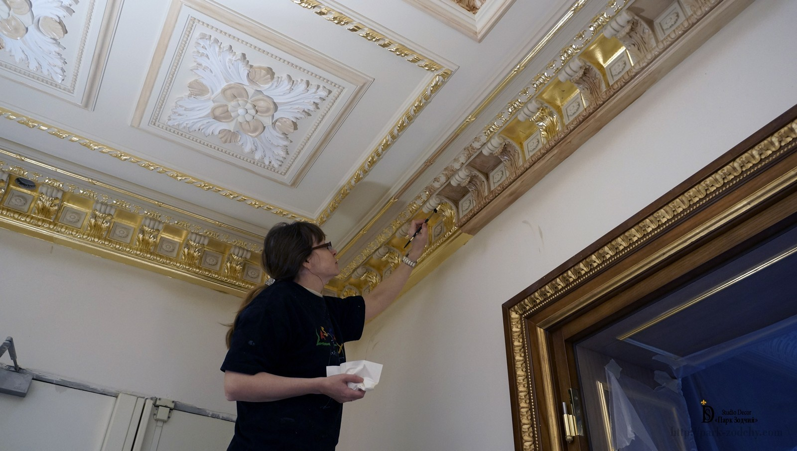 The gilded mouldings