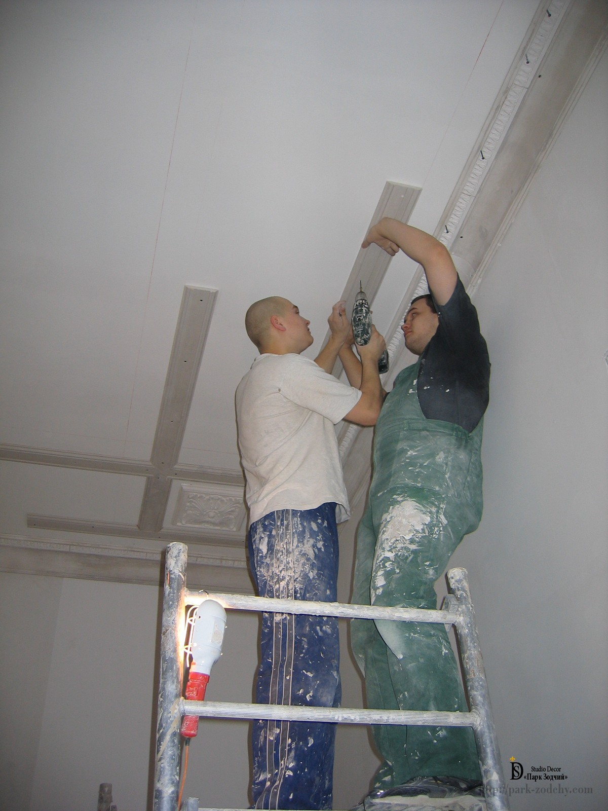 installation of the molding on the ceiling